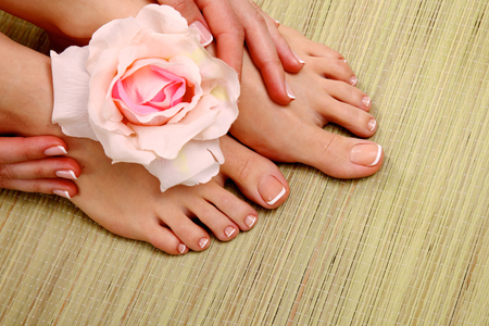 french pedicure: Beautiful feet with perfect spa french nail pedicure .
