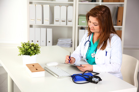 Portrait of happy medical doctor woman in office. Stock Photo