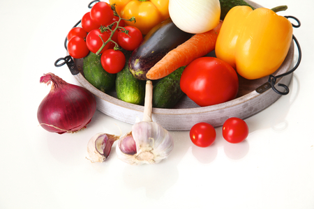 consuming: Composition with assorted raw organic vegetables on table. Stock Photo