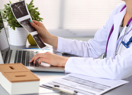 office cabinet: Portrait of happy medical doctor woman in office. Stock Photo
