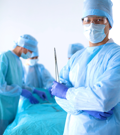cardiac surgery: Team of surgeon in uniform perform operation on a patient at cardiac surgery clinic.