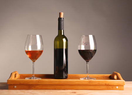wine testing: wine bottle and wine glass on a glass table.