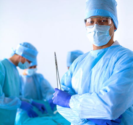 physicals: Team of surgeon in uniform perform operation on a patient at cardiac surgery clinic.