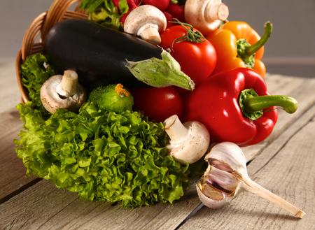 food basket: Vegetables . Fresh Bio Vegetable in a Basket. Over Nature Background. Stock Photo