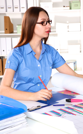 decreased: Worried businesswoman in bankruptcy watching decreased sales statistics in a paper document at office. Stock Photo