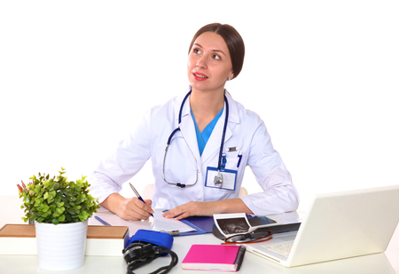 general practitioner: Beautiful general practitioner is working with joy. She is standing with a folder of documents in her hand.