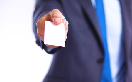 tradeswoman: young businessman holds out his hand with a business card for love.