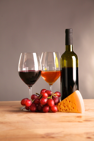 closed corks: on the table a bottle of wine and a glass of wine. Stock Photo