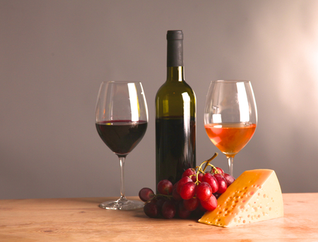 on the table a bottle of wine and a glass of wine. Stock Photo