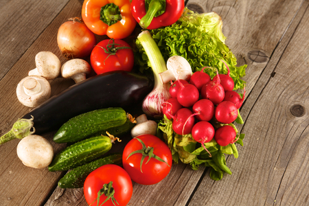 food basket: Fresh vegetables on a clean wooden table.
