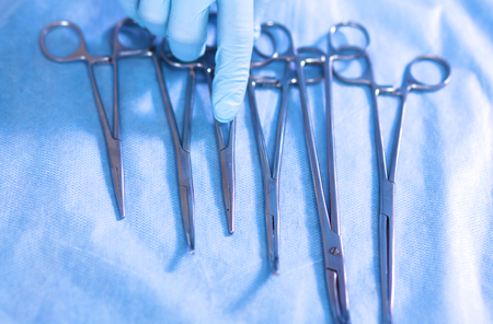 operating table: surgical instruments, laid out on an operating table. Stock Photo