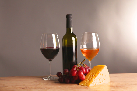 closed corks: bottle of wine and glass on the table.