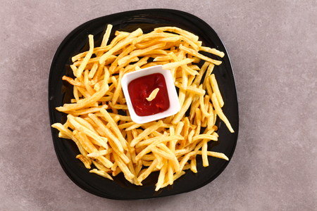french fries plate: French fries on the plate standing on the wooden table. Stock Photo