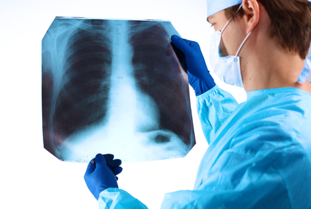 Doctor examining an X-ray of the patient. Stock Photo