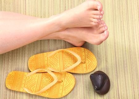 beautiful feet: Closeup photo of a beautiful female feet with red pedicure.