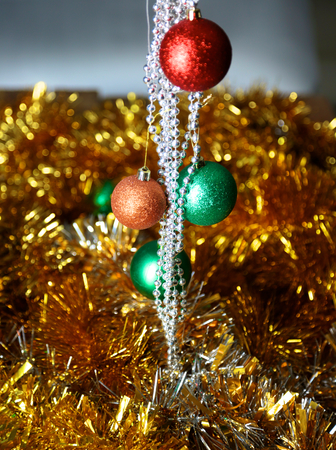 decorated tree: Gold Christmas background of de-focused lights with decorated tree.