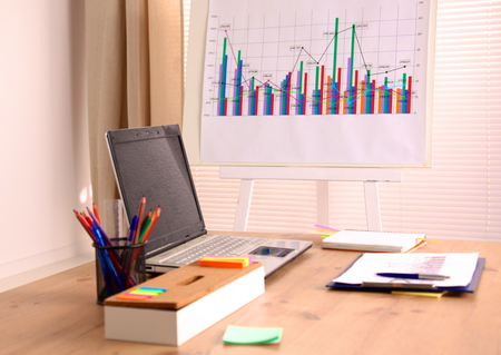 Designer working desk with a computer and paperwork. Stock Photo