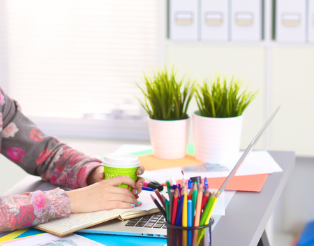 Designer working at desk using digitizer in his office. Stock Photo