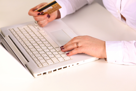 Young businesswoman working on a laptop Stock Photo