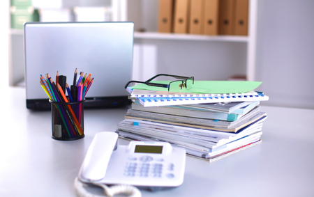 data archiving: Group of multicolored office folders and glasses Stock Photo