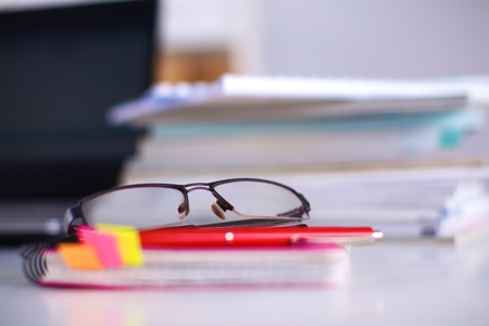 Group of multicolored office folders and glasses Stock Photo