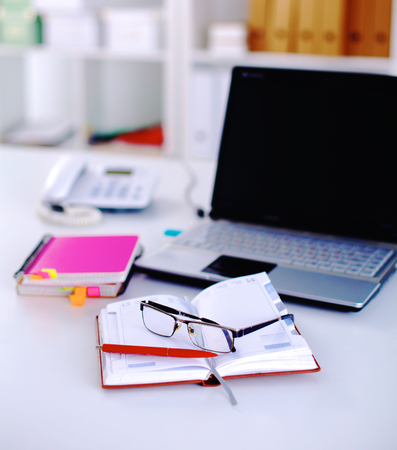 biz: Group of multicolored office folders and glasses Stock Photo