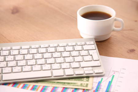 on the desktop computer and a cup of coffee Stock Photo