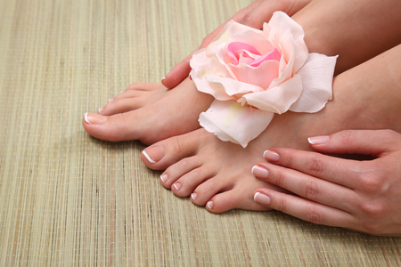 pedicure on legs and beautiful manicure on hands closeup Stock Photo