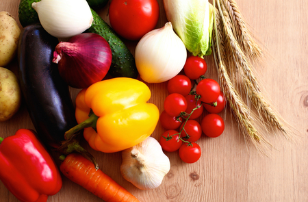 Composition with assorted raw organic vegetables wooden table Stock Photo