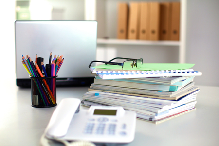 Points on the office desktop with a computer and documents. Stock Photo