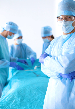 Team of surgeon in uniform perform operation on a patient at cardiac surgery clinic Stock Photo