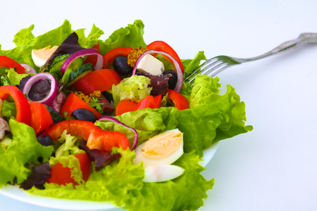 house ware: salad from fresh vegetables in a plate on a table, selective focus