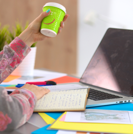 Designer working at desk using digitizer in his office