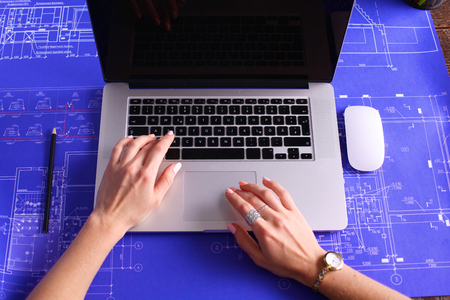 comfortable: Cropped image. Professional businesswoman working at computer.