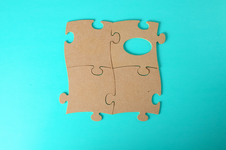 puzzles close-up lie on a blue table. Stock Photo