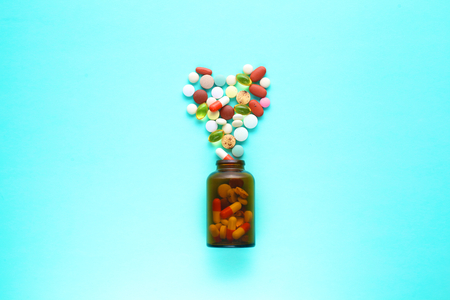 Medical pills and a bottle lie on the table. Medical concept