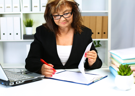 the woman behind the desk in the Office