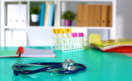 prescription pad: Doctors workspace working table with patients discharge blank paper form, medical prescription, stethoscope on desk