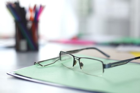 glasses on your desktop. work with drawings. business plan. stapler, magnifier Stock Photo
