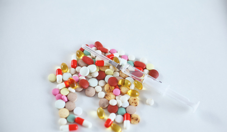 Medical pills and a bottle lie on the table. Medical concept.