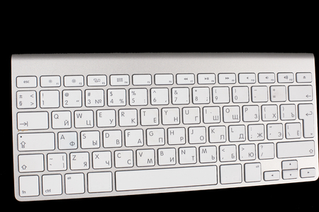 Modern aluminum keyboard top view isolated on a black background