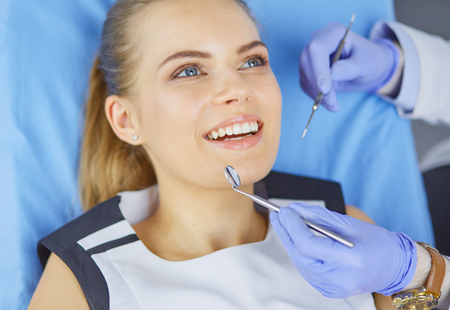 beautiful girl in the dental chair on the examination at the dentist