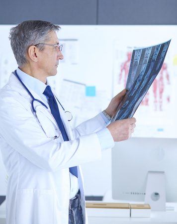 Doctor in the office examines the patients x-ray
