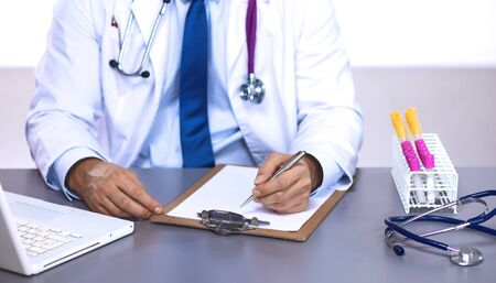 young doctor in the Office makes an entry.
