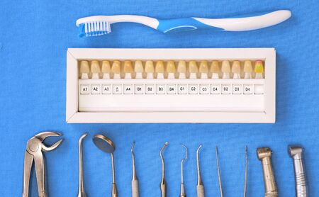 surgical instruments and tools including scalpels, forceps and tweezers arranged on a table for a surgery.