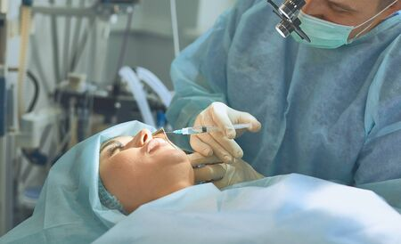 Several doctors surrounding patient on operation table during t Reklamní fotografie