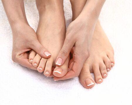 Closeup photo of a beautiful female feet with pedicure. 版權商用圖片