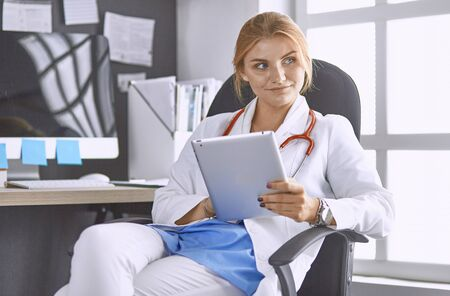 young woman doctor takes patient in office