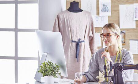 pretty dressmaker showing a new design to her client Stok Fotoğraf
