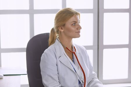 young woman doctor takes patient in office 스톡 콘텐츠